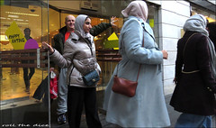 `2863 (roll the dice) Tags: london westminster lights w1 doors exit westend selfridges mad sad fun funny happy smile angry reaction muslims culture pretty sexy girls streetphotography people veiled fashion headscarf burka uk classic art unaware unknown canon tourism tourists cold colour reflection england portrait candid strangers natural wisdom arab surreal eating bags dark nose eyes face