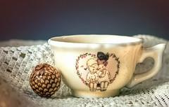 Dolly's Tea Cup (docoverachiever) Tags: stilllife cup macro object girls macromondays home vintage toy porcelain tea lace macromondaysceramic
