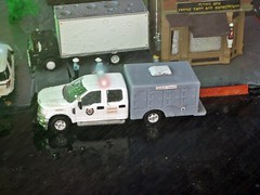 1-21-2020 Rain and Dog . (THE RANGE PRODUCTIONS) Tags: speccast greenlight athearn ford boxtruck fordf350 fordpoliceinterceptorutility 164scale dioramas 187scale truck hoscalefigures diecast diecastdioramas display toy model rain hoscale modular
