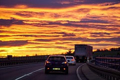 On the road (A.K. 90) Tags: skyline skyglory sky himmel cloudssunsetsstormssunrise cloudscapes clouds wolken sunrise sonnenaufgang sunlight lightsandshadows lichtschatten sonnenlicht street travel journey reise fahrt strase morning morgenrot morgens redyelloworange colors farben car auto lkw drive road sonyalpha6300 e18135mm3556oss vehicle transport transportation newday start