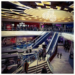 Spaghetti Junction.... (joanneharlow70) Tags: manchesterarndale manchester shoppingcentre people lights escalators steps shops shopping vendors architecture children chairs tables logos signs