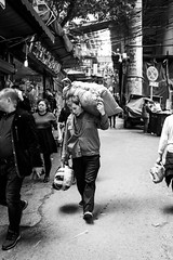 The last trip (Go-tea 郭天) Tags: chongqing républiquepopulairedechine man alone lonely portrait package back heavy load loaded hard difficulty difficult carried carry carrying shoulder weight walk walking sun sunny shadow hot warm street urban city outside outdoor people candid bw bnw black white blackwhite blackandwhite monochrome naturallight natural light asia asian china chinese canon eos 100d 24mm prime