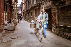 The milk man. (Goran Bangkok) Tags: bhaktapur nepal street vendor milk streetphotography bicycle food man happyplanet asiafavorites