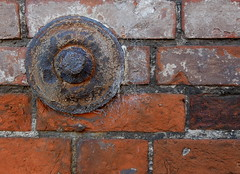 Square peg in a round hole (Grooover) Tags: wall plate disc rust brick beccles suffolk grooover