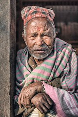 Tired (Roberto Pazzi Photography) Tags: one adult only wrinkled senior photography glance person outdoor nikon namaste pray man street travel elder nepal face asia bhaktapur culture place smile happy hat people human nepalese cane hands