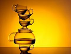 Tea Stack (Karen_Chappell) Tags: tea teapot teacup glass orange yellow balance stack tipsy stilllife beverage liquid product