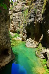 beautiful canyon (majka44) Tags: andalucia spain travel green nature andalusia view ronda canyon blue sky reflection nice memory holiday stone rocks river water light shadow deep
