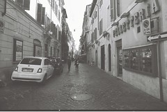 Roma (goodfella2459) Tags: nikonf4 afnikkor24mmf28dlens ilforddelta100 35mm blackandwhite film analog city streets road pedestrians buildings roma italy rome bwfp
