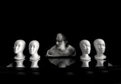 Self portrait. (Caroleyene) Tags: selfportrait blackbackground blackandwhite bw shutterdrag blur mannequinheads mannequin