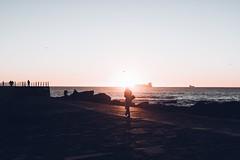 Walking on sunshine. (J'Antunes) Tags: beach silhouettes sunset sun sky orange colors shadow people life canon matosinhos porto photography birds sea ocean