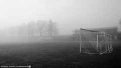 A foggy morning at the football field. (andreasheinrich) Tags: landscape footballfield trees grass goal morning winter december fog blackandwhite blackandwhitephotos cold moody foggy germany badenwürttemberg neckarsulm dahenfeld deutschland fussballplatz bäume gras tor morgen dezember nebel schwarzweis kalt düster neblig nikond7000