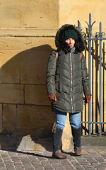 Feminine Graciously Under Wintry Wears... (Last Border of the Picture) Tags: feminine under wintry graciously wears wall jaumont church cathedral france europe boots jacket gloves woman gir brune hair long stand pavement jean fleece blue green khaki backpack screw marron cap scarp eyes nose smile mouth zip closed pocket