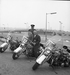 Minister of Highways, Phil Gaglardi on a Highway Patrol Motorcycle, 1964 (TranBC) Tags: highway patrol groupphoto highwaypatrol 19001999 1960s 1964 june thursday historical historic
