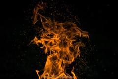 element (pajus79) Tags: nikon d80 nikkor flame fire element heat hot dark sparks shape fireplace black light nature