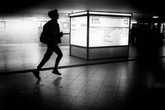 U-Bahn in a hurry (Rien van Voorst) Tags: streetphotography straatfotografie strasenfotografie fotografíacallejera photographiederue fotografiadistrada monochrome city urban highcontrast ubahn metro tube run rennen deutschland germany duitsland berlin berlijn