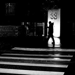 Behind the crosswalk (pascalcolin1) Tags: paris13 homme man nuit night lumière light pluie rain reflets reflection passagepiéton piéton porte door photoderue streetview urbanarte noiretblanc blackandwhite photopascalcolin 50mm canon50mm canon