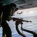 A U.S. Marine Corps , crew chief fires an M240B machine gun during a tail gunnery exercise