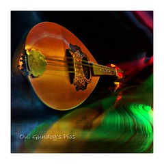 Mandolin Wind (Oul Gundog) Tags: mandolin wind lights trails reflections steel stainless music stewart rod twat faces light grafitti still life h