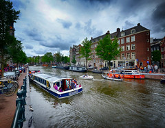 Boat ride in Amsterdam, The Netherlands (` Toshio ') Tags: toshio amsterdam thenetherlands holland europe european europeanunion boat river cruise clouds city fujixe2 xe2 people riverbank bicycle tourists pigeon trees boathouse boating
