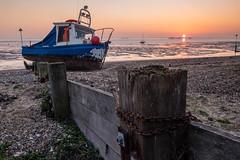 After Storm Brendan. (daveknight1946) Tags: essex thorpebay sunset boat fishingboat sand beach chain breakwater buoy pier lowtide