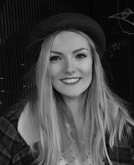 Big smile (Nikonsnapper) Tags: olympus omd em5 cardiff street portrait bw blonde smile hat busker leica sumilux 25mm