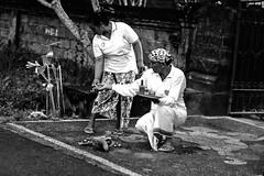 Balinese couple performing street offering (Tiket2) Tags: asia asiatravel indonesia travel travelpic travelphoto indonesian amazing stunning tiket2 creativecommons free freephoto attribution tourism tourist exotic tropical spirit spiritual purification cleansing water holy hindu bali balinese traditional tirta empul tirtaempul pray praying