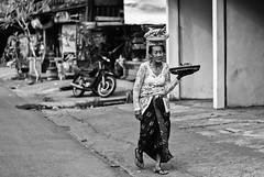 Balinese woman (Tiket2) Tags: asia asiatravel indonesia travel travelpic travelphoto indonesian amazing stunning tiket2 creativecommons free freephoto attribution tourism tourist exotic tropical balinese woman traditional clothes bali black white blackwhite blackandwhite bw