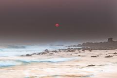 Red Sun Smoke Haze Seascape (Merrillie) Tags: daybreak smokehaze outdoors nature water morning sea redsun dawn landscape newsouthwales rocks earlymorning nsw summer coast ocean sunrise waterscape macmasters coastal macmastersbeach sky seascape australia centralcoast bushfires waves
