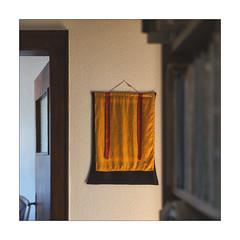 Thangka in morning light (Armin Fuchs) Tags: arminfuchs lavillelaplusdangereuse thangka tibet yellow red door room square niftyfifty