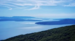 The blue seas of Croatia (kate willmer) Tags: blue sun sky sea light clouds islands peninsula istria croatia