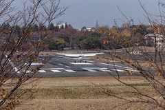 A SMALL AIRPORT, SOME PARKS AND CLOUDS - CXCIII (Jussi Salmiakkinen (JUNJI SUDA)) Tags: chofu tokyo tokio japan japani cityscape park airport sky aircraft wood airplane landscape tama 調布 飛行場 空港 林 森 空 武蔵野 多摩 東京 日本 風景 clouds 2019 talvi joulukuu early december woods tree winter earlywinter cessna landing