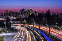 Swerve into Calgary (TIA International Photography) Tags: calgary alberta ab canada skyline downtown cityscape bluehour dawn bowtrail highway freeway expressway light trails stream headlights taillights lane commute silhouette urban landscape city centre center metropolis early morning tosinarasi tia ©tiainternationalphotography transportation transit