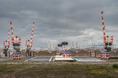 Wacht (Markus Lehr) Tags: signs barrier sky transitional industriallandscape railway manmadelandscape contemporaryphotography rotterdam maasvlakte holland markuslehr