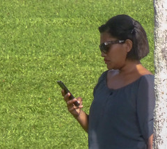 Stylish Woman Checking Phone (mikecogh) Tags: suva fiji stylish checking phone sunglasses