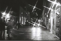 Roma (goodfella2459) Tags: nikonf4 afnikkor50mmf14dlens kodaktrix400 35mm blackandwhite film night analog city streets cars pedestrians roma italy buildings filter crossstarfilter lensfiltersgroup rome light bwfp