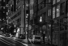 last stop on spear street (pbo31) Tags: sanfrancisco california nikon d810 blackandwhite monochrome night dark black january 2020 boury pbo31 city urban winter rinconhill harrisonstreet lightstream roadway traffic motion spear street latenight