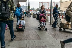 17drg0399 (dmitryzhkov) Tags: urban city everyday public place outdoor life human social stranger documentary photojournalism candid street dmitryryzhkov moscow russia streetphotography people man mankind humanity color colour bad weather rain umbrella