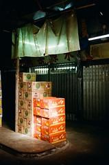 Stacked boxes of Watermelon & Tomatoes (wargreymoni) Tags: analog film minolta cle kodak colorplus200 fruit market