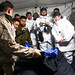 Conducts a class to show the Soldiers from Japan Ground Self-Defense Force the emergency hypothermia kit