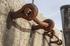 Harbor Hardware (brucetopher) Tags: ladder rung rusted rust rusty decay harbor wall rocks hardware metal steel