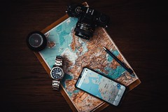 Smartphone beside watch and camera - Credit to https://homegets.com/ (davidstewartgets) Tags: camera lens cellphone direction electronics film flat lay flatlay google maps map mobile phone plan travel watch wristwatch
