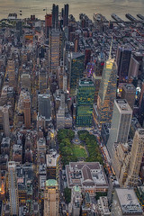Aerial Bryant Park NYC (Susan Candelario) Tags: 42ndst cityscapes aerialview f esb eastriver hudsonriver empirestatebuilding chryslerbuilding flatironbuilding lowermanhattan categories 42ndstreet flatirondistrict commercialbuilding nyc newyorkcity ny newyork manhattan timessquare northamerica manhattanskyline topview nycskyline metlifebuilding newyorkcityskyline oneworldtradecenter newyorklifeinsuranceco susancandelario metlifeinsuranceco sdcgeographiclocation city architecture lights evening unitedstates dusk worldtradecenter aerial architectural illuminated land bluehour iconic bryantpark birdseyeview aerials viewfromabove sunset signs skyline skyscraper twilight scenery skyscrapers sundown skylines sunsets midtown neonsign lit nightfall midtownmanhattan upperview urban urbanlandscape urbanskyline urbanaerial