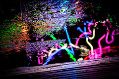 The Streets Paved with Light (Matthew Bickham) Tags: canarywharf winterlights neon colour wet rain