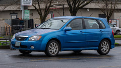 2006 Kia Spectra5 (mlokren) Tags: 2020 car spotting photo photography photos pic picture pics pictures pacific northwest pnw pacnw oregon usa vehicle vehicles vehicular automobile automobiles automotive transportation outdoor outdoors 2006 kia spectra5 spectra 5 hatch hatchback blue