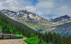 Returning to Skagway (http://fineartamerica.com/profiles/robert-bales.ht) Tags: alaska forupload haybales landscape people photo places projects scenic sky toworkon travel tourism railroad nature mountain forest vacation wilderness route rock adventure north woods view tourist rush cliff gold fall ride tour excursion tree summer railway cruise whitehorse yukon pass rail bridge abandoned scenery broken skagway wagons wooden klondike historic snow summit mountainsfamous valley passage america usa town canada passenger bennett locomotive attraction train robertbales