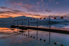 日月潭.蔣公碼頭~日出雲彩~  Sun moon lake Sunrise (Shang-fu Dai) Tags: 台灣 taiwan 日月潭 南投 魚池 sonya7r2 sunrise 日出 canon1635mmf28 sky 雲彩 landscape formosa dawn 碼頭 蔣公碼頭 sunmoonlake clouds 日落 水 天空 happyplanet asiafavorites
