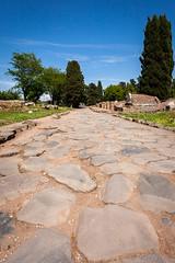rome-4783 (yukkycakes) Tags: rome italy ostiaantica archeologicalsite mainroad decumanusmaximus rough uneven stone trees