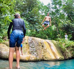 Jumping into the water at Mele Cascades, December 2019