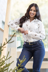 Photo of Lady posing wearing a white country print shirt