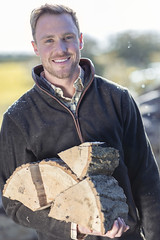Man wearing a country fleece holding logs (Rydale Country Clothing) Tags: man fleece fleeces moleskin country outfit countryside logs fire wood rydale